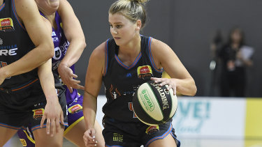 Shyla Heal drives to the basket during Townsville's WNBL win over the Melbourne Boomers on Sunday.