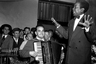 Vocalist Nellie Small and accordionist Gus Merzi perform at the Hotel Castlereagh on August 20, 1954.