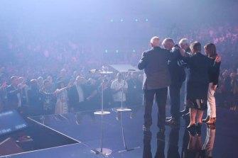 Australian Prime Minister Scott Morrison receives a blessing at the Australian Christian churches conference.