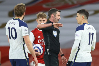 Erik Lamela gets his marching orders from referee Michael Oliver.