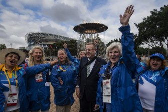 AOC President John Coates in 2020 with volunteers at the Lighting of the Cauldron, celebrating the 20-year anniversary of the opening of the Sydney 2000 Olympic and Paralympic Games.