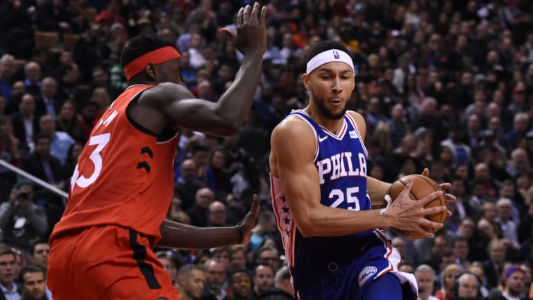 Mixed night: Ben Simmons dribbles past Toronto Raptors forward Pascal Siakam at Scotiabank Arena in Toronto.