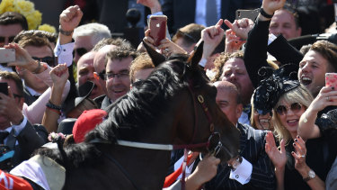 Popular winner: Extra Brut is hailed by an appreciative crowd after winning the Victoria Derby.
