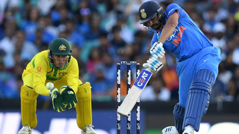 Lone hand: Rohit Sharma hits over the top during his century at the SCG.