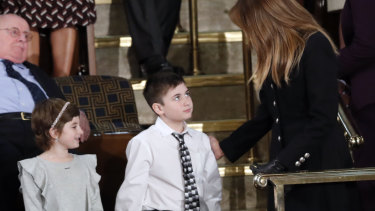 Guests Grace Eline and Joshua Trump, greet first lady Melania Trump before Donald Trump delivered his speech.