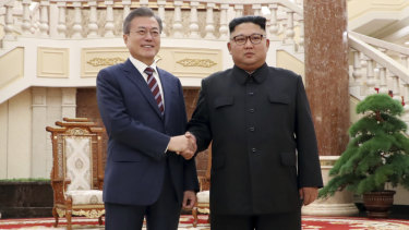 South Korean President Moon Jae-in, left, and North Koran leader Kim Jong-un stand at the headquarters of the Central Committee of the Workers' Party in Pyongyang, North Korea.