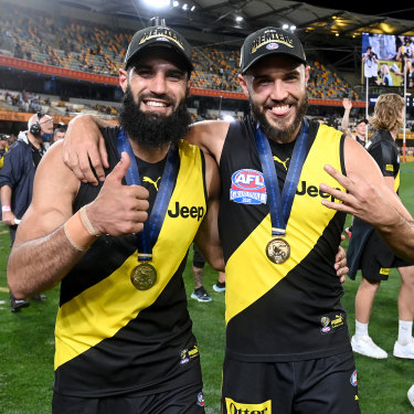 Bachar Houli and Shane Edwards celebrate victory after the 2020 AFL grand final.