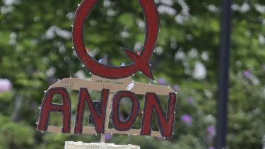QAnon conspiracies spread among believers.
