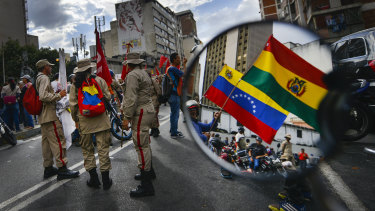 Supporters of Venezuelan President Nicolas Maduro rally in support of Evo Morales in Caracas.