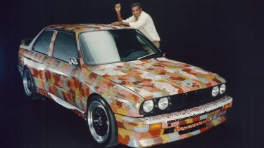 Kumantjayi Nelson Jagamara strikes a pose with his Art Car at the BMW studio.
