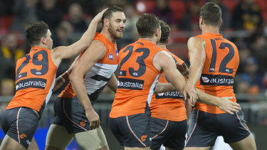 The Giants in action, including returning ruckman Shane Mumford.