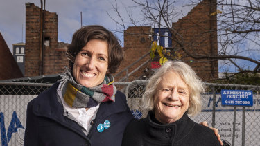 La Mama Theatre company manager Caitlin Dullard and artistic director Liz Jones outside the remains of the company's Faraday Street building shortly after it was lost in a fire.