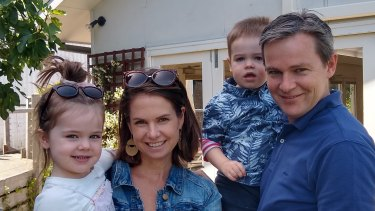 Tim Moore and Anna Moore with their children.
