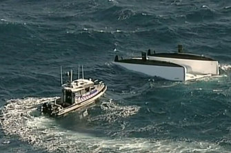 Three dead, two rescued after boat capsizes off Newcastle coast.
