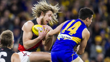 Hair-raising action: Essendon skipper Dyson Heppell takes a grab against West Coast in round 14.