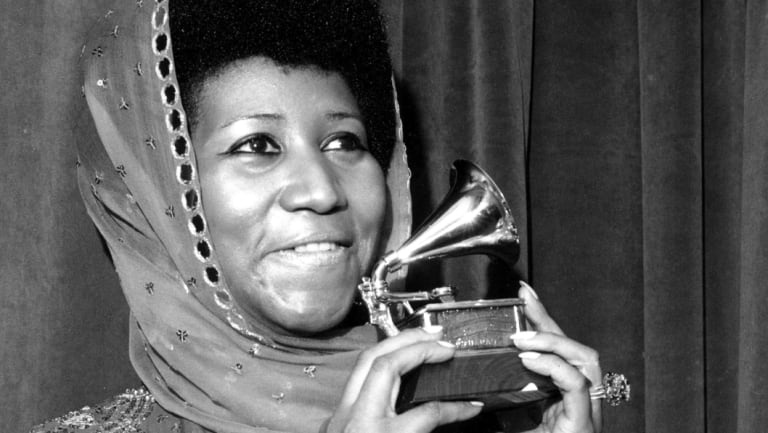 Aretha Franklin with her 1975 Grammy Award for Best Female R&B Vocal Performance.