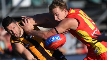 A Sun no more: Tom Lynch battles for the ball.