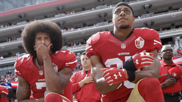 Colin Kaepernick and Eric Reid kneel during the national anthem in October 2016.