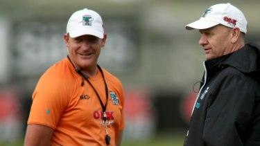Port Adelaide assistant coach Michael Voss, pictured with coach Ken Hinkley, could be eyeing a return to senior coaching.
