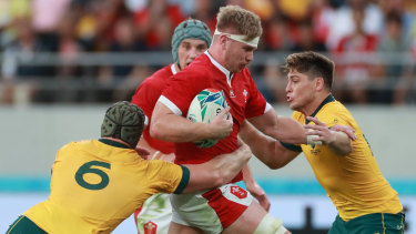 Wales' Aaron Wainwright is tackled by Pocock (left) and James O'Connor.