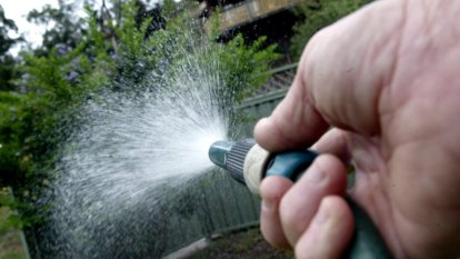 Man accused of spraying neighbours with a hose wins assault appeal