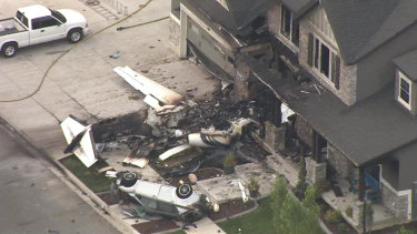 The small plane crashed into the front of the house.