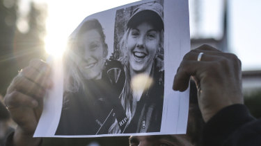 Pictures of Maren Ueland and Louisa Vesterager Jespersen are displayed during a candlelight vigil outside the Norwegian embassy in Rabat.