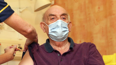 Brian Pinker, 82, receives the Oxford University/AstraZeneca COVID-19 vaccine in Oxford on January 4.