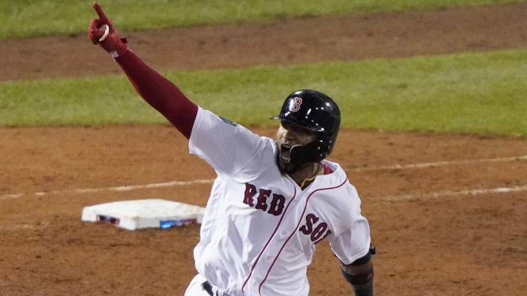 Biggest stage: Boston Red Sox's Eduardo Nunez rounds the bases after hitting a three-run homer.