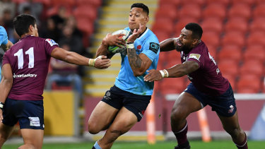 In form: Israel Folau runs the ball during the Waratahs' defeat of the Reds on Saturday night.