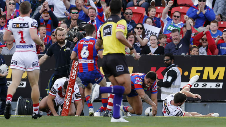 Early running: Ken Sio crosses out wide for the Knights.