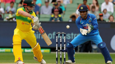 Shaun Marsh plays and misses during the Third One-Day International match between Australia and India at the MCG.