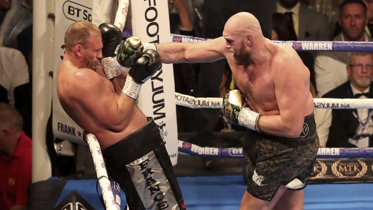 Cruising: Tyson Fury (right) in action against Francesco Pianeta in Belfast.