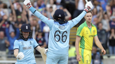 England's captain Eoin Morgan, left, celebrates with teammate Joe Root after winning their semi-final.