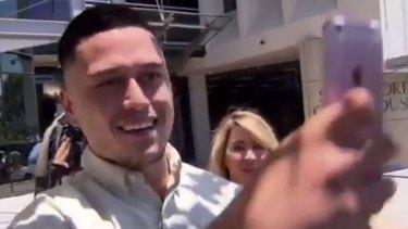 Caleb Maraku, laughing and taking selfies as he left court.