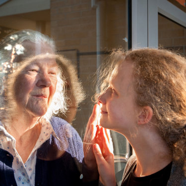 Grandmother Margaret Wheeler greets her granddaughter Alice Sarah-Lay through the glass at the Trentham Aged Care Facility. It's one of hundreds of images that make up Ballarat Foto's Mass Isolation project.