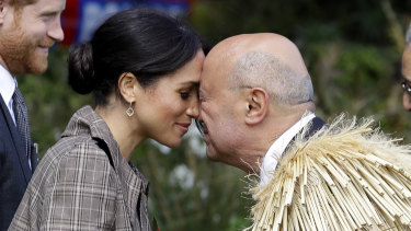 "Meghan, Duchess of Sussex receives a ""hongi"" a traditional Maori welcome on the lawns of Government House in Wellington, New Zealand in 2018."