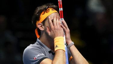 Dominic Thiem of Austria reacts after winning match point against Alexander Zverev.
