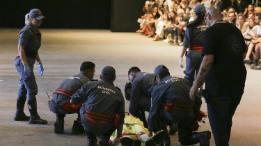 Paramedics rush to the aid of model Tales Soares after he collapsed during Sao Paulo Fashion Week.