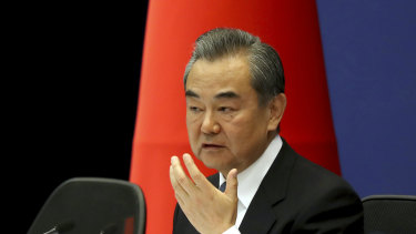 Chinese Foreign Minister Wang Yi at the announcement.