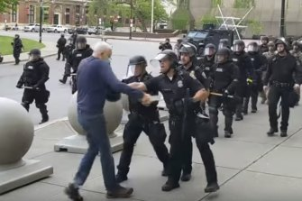 In this image from video provided by WBFO, a Buffalo police officer appears to shove a man who walked up to police on Thursday, June 4, in Buffalo, NY.