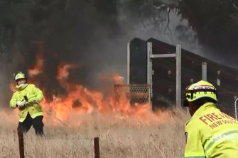 As of midday on Sunday, firefighters were battling 51 fires across NSW, with 18 of them yet to be contained, the Rural Fire Service said.
