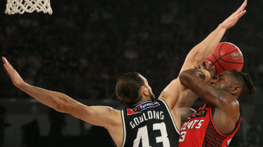 Wildcat Terrico White attempts to get a shot away under pressure from Goulding of United.