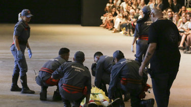 Model Tales Soares is taken from the catwalk by paramedics after he collapsed during Sao Paulo Fashion Week in Sao Paulo.