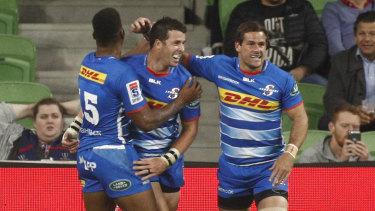 Ruhan Nel celebrates a try with his Stormers teammates.