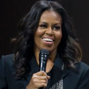 """Michelle Obama speaks to the crowd as she presents her anticipated memoir """"Becoming"""" during her book tour stop in Washington, Saturday, Nov. 17, 2018. (AP Photo/Jose Luis Magana)"""