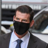 Roberts-Smith defamation trial halted as COVID-19 'flares' in NSW