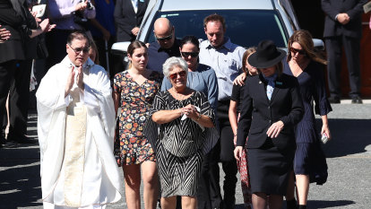 'I love you Dad': Raudonikis' son gives moving eulogy at packed funeral
