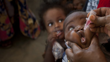 A baby receives a polio vaccine at the Medina Maternal Child Health Centre in Mogadishu, Somalia.
