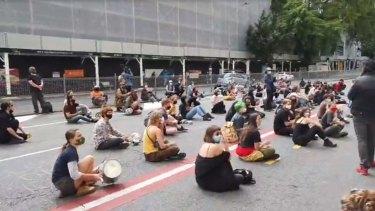 Black Lives Matter protesters descend on Queensland police headquarters in Brisbane on Friday.